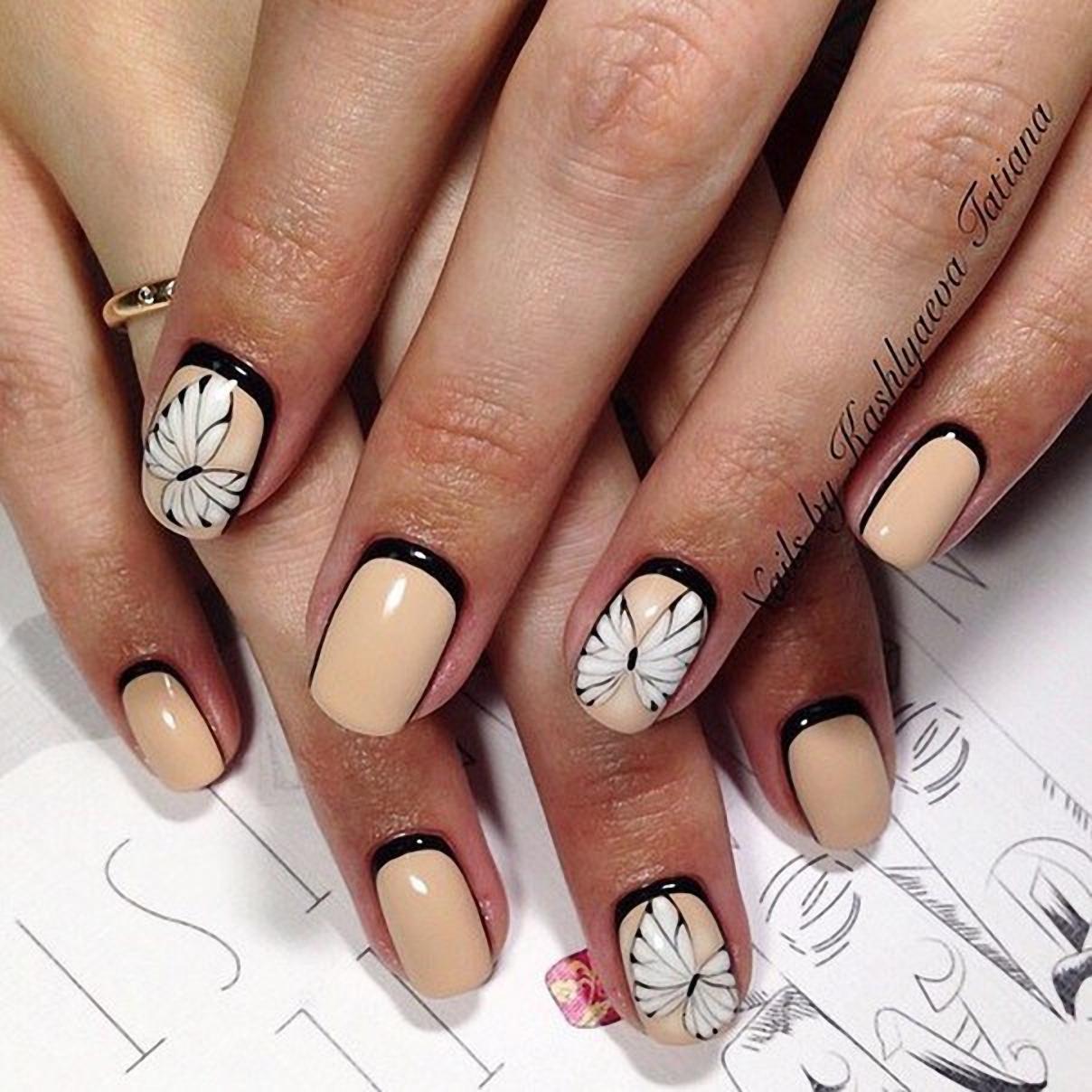 Дизайн бабочки на ногтях 654